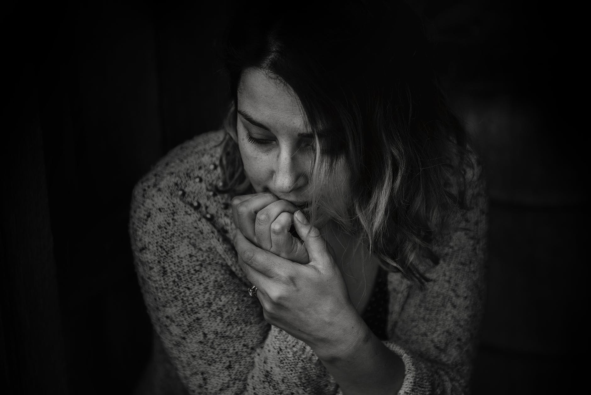 greyscale photography of woman wearing long sleeved top