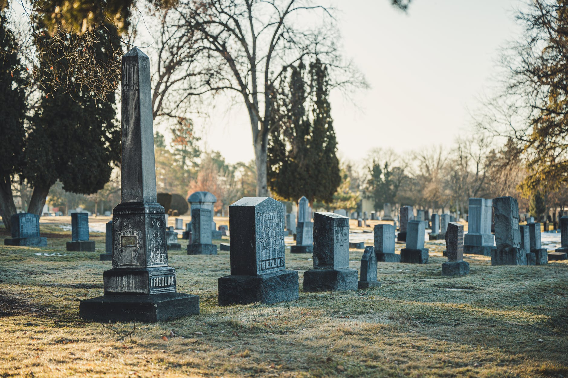 photo of tombstones on grass field